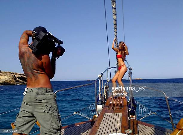 Suzie Carina a Czech porn actress and model poses onboard a yacht off the coast of Ibiza Balearic Islands whilst a camera man films her on Tuesday...