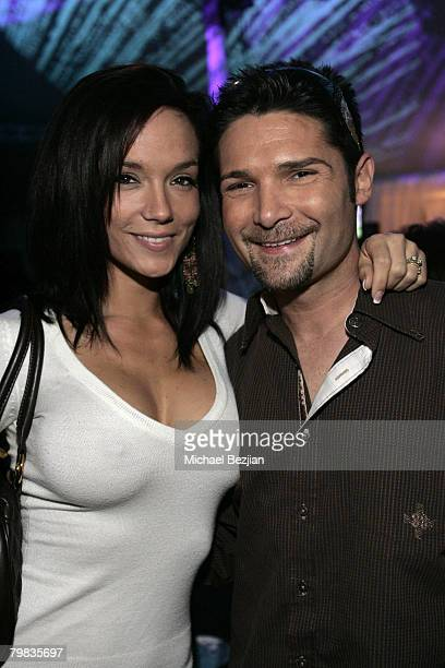 Suzie Feldman and Corey Feldman pose at the Playboy Mansion Super Bowl Party on February 3 2008 in Los Angeles California