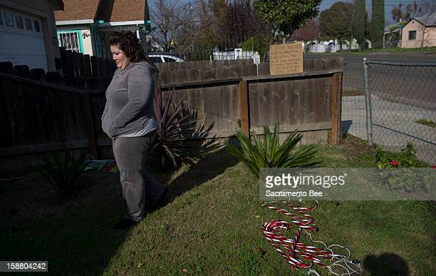 Suzie Ortiz of south Stockton, California, takes a moment on December 11 after she took what Christmas decorations she had left at her modest home...