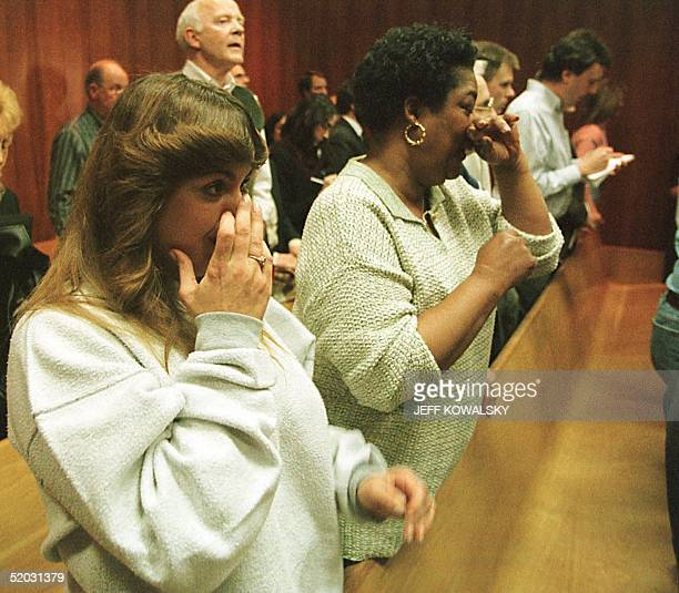 Suzie Pokinghorn and Jackie Mullins react to Dr Jack Kevorkian being convicted of seconddegree murder at Oakland County Circuit Court on 26 March...
