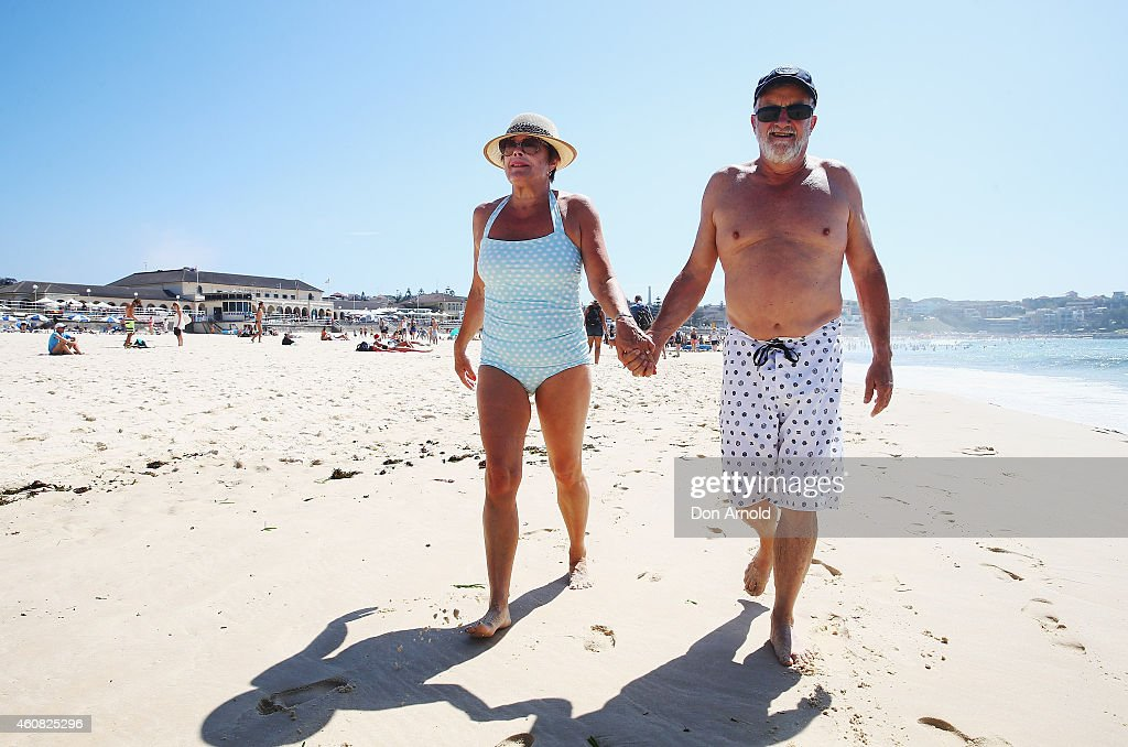 Suzie Reed and Russell Reed stroll along the waters edge at Bondi Beach on December 25, 2014 in Sydney, Australia. Bondi Beach is a popular tourist destination on Christmas Day.