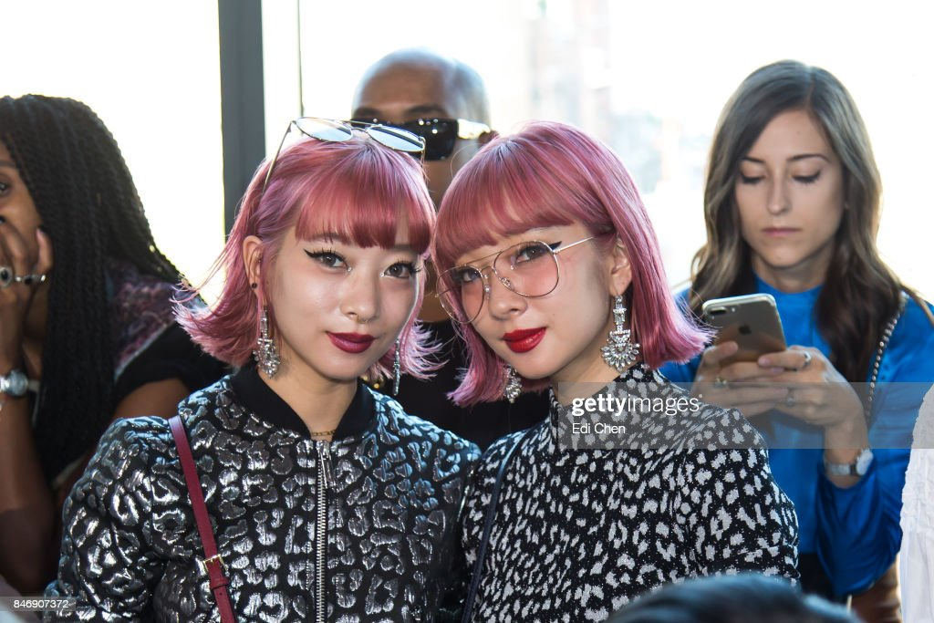 Suzui Ami & Suzuki Aya attend the Michael Kors runway show during New York Fashion Week at Spring Studios on September 13, 2017 in New York City.