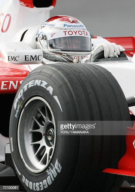 Italian driver JarnoTrulli wheels his Toyota during a free practice session of the Formula One Japanese Grand Prix in Suzuka Circuit in Suzuka...