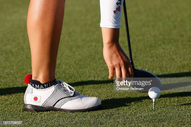 Suzuka Yamaguchi of Japan places her ball on the first hole during the second round of the LPGA LOTTE Championship at Kapolei Golf Club on April 15,...