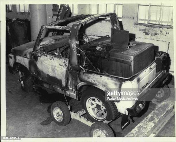 Suzuki Burntout Suzuki 4wd vehicle still with the safe in it that police said was involved in the murder of 59yearold Mr Merv Malouf The car is...