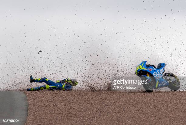Suzuki Ecstar rider Italian Andrea Iannone falls during the first training session of the Moto Grand Prix of Germany at the Sachsenring Circuit on...