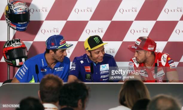 Suzuki Ecstar's Italian driver Andrea Iannone Movistar Yamaha's Italian driver Valentino Rossi and Ducati's Italian driver Andrea Dovizioso attend a...