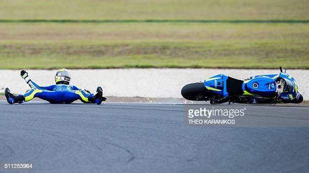TOPSHOT Suzuki Ecstar's Spanish rider Aleix Espargaro comes off his bike at turn 4 during the third day of the 2016 preseason MotoGp motorcycling...