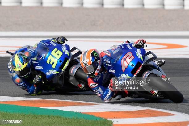 Suzuki Ecstar's Spanish rider Alex Rins and Suzuki Ecstar's Spanish rider Joan Mir compete in the MotoGP race of the European Grand Prix at the...
