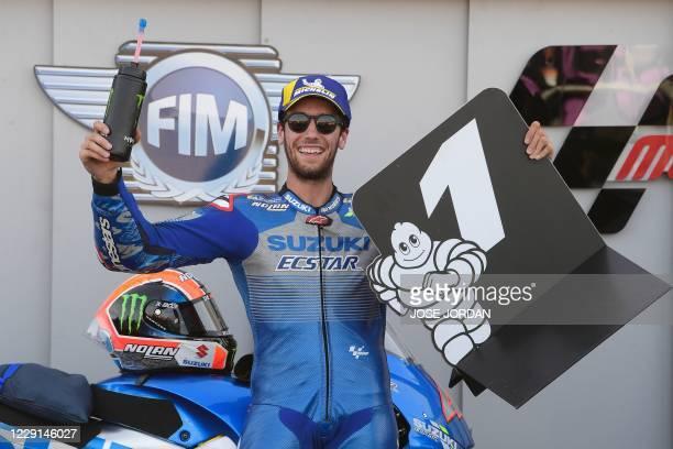 Suzuki Ecstar's Spanish rider Alex Rins celebrates after winning the MotoGP race of the Moto Grand Prix of Aragon at the Motorland circuit in Alcaniz...