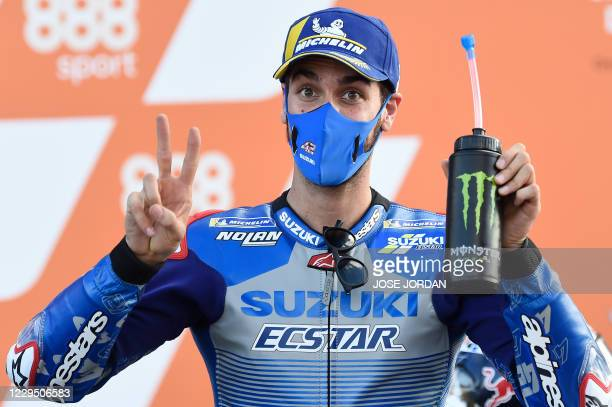 Suzuki Ecstar's Spanish rider Alex Rins celebrates his second place after the qualifying session of the MotoGP race of the European Grand Prix at the...