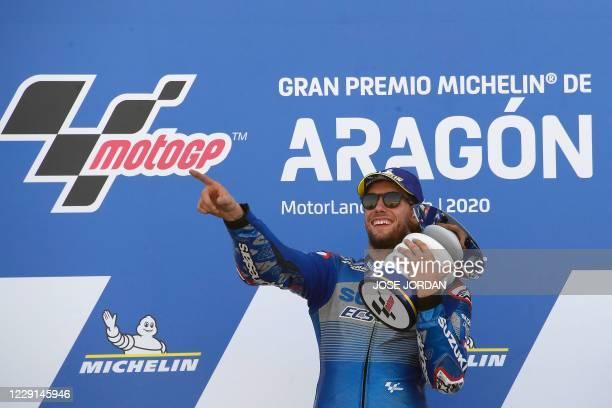 Suzuki Ecstar's Spanish rider Alex Rins celebrates on the podium after winning the MotoGP race of the Moto Grand Prix of Aragon at the Motorland...