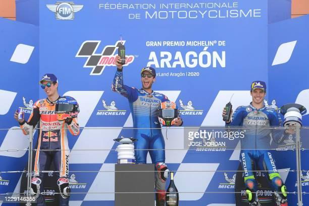 Suzuki Ecstar's Spanish rider Alex Rins celebrates , Repsol Honda Team's Spanish rider Alex Marquez and Suzuki Ecstar's Spanish rider Joan Mir...