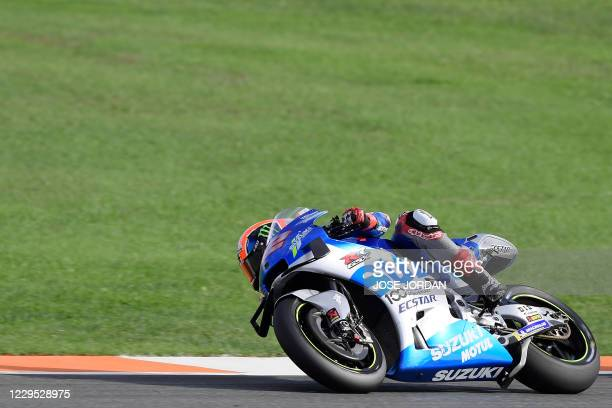 Suzuki Ecstar's Spanish rider Alex Rins competes in the MotoGP race of the European Grand Prix at the Ricardo Tormo circuit in Valencia on November...