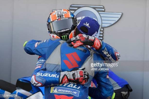 Suzuki Ecstar's Spanish rider Alex Rins hugs Suzuki Ecstar's Spanish rider Joan Mir after winning the MotoGP race of the Moto Grand Prix of Aragon at...