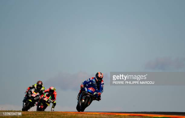 Suzuki Ecstar's Spanish rider Alex Rins takes a curve during the first free practice session of the MotoGP race of the Grand Prix of Teruel at the...