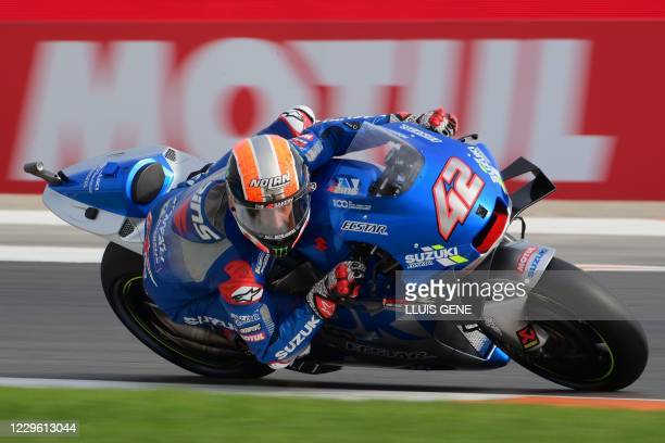 Suzuki Ecstar's Spanish rider Alex Rins takes part in the third practice session of the MotoGP Valencia Grand Prix at the Ricardo Tormo circuit in...