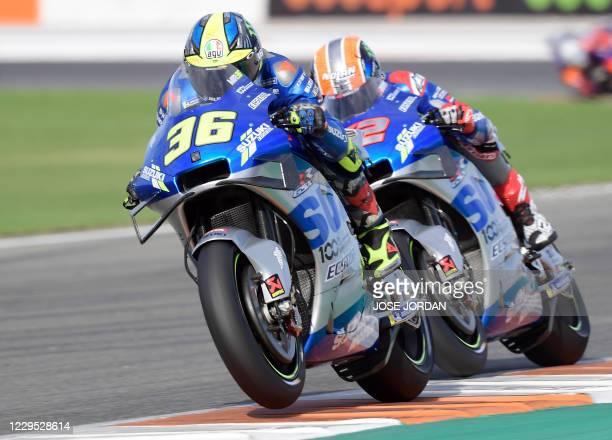 Suzuki Ecstar's Spanish rider Joan Mir competes ahead of Suzuki Ecstar's Spanish rider Alex Rins in the MotoGP race of the European Grand Prix at the...