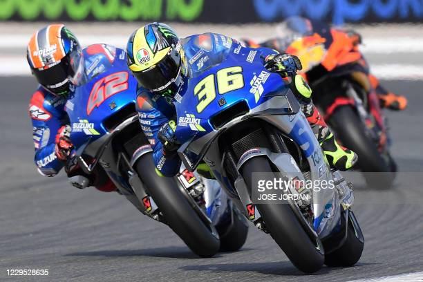 Suzuki Ecstar's Spanish rider Joan Mir drives ahead of Suzuki Ecstar's Spanish rider Alex Rins in the MotoGP race of the European Grand Prix at the...