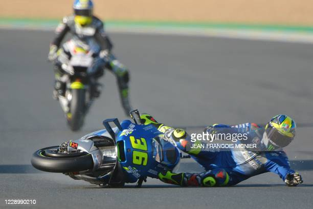 Suzuki Ecstar's Spanish rider Joan Mir falls from his motorbike during the third free practice session ahead of the French MotoGP race on October 10,...