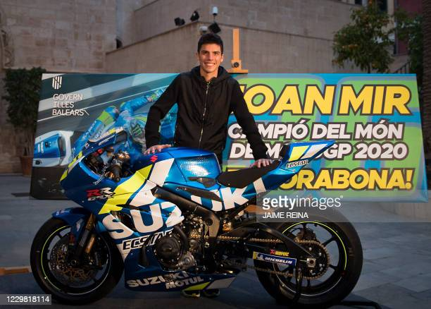 Suzuki Ecstar's Spanish rider Joan Mir poses with his motorbike outside the Balearic Government headquarters during the celebration of his MotoGP...