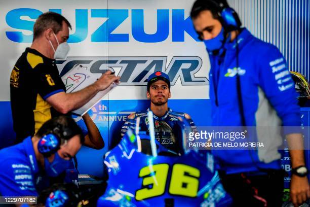 Suzuki Ecstar's Spanish rider Joan Mir prepares for the third practice session of the MotoGP Portuguese Grand Prix at the Algarve International...