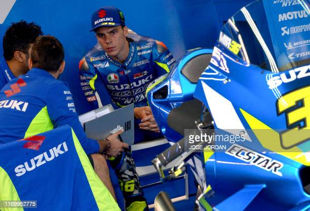 Suzuki Ecstar's Spanish rider Joan Mir speaks with staff in the box ahead of the third MotoGP free practice session of the Moto Grand Prix of Aragon...