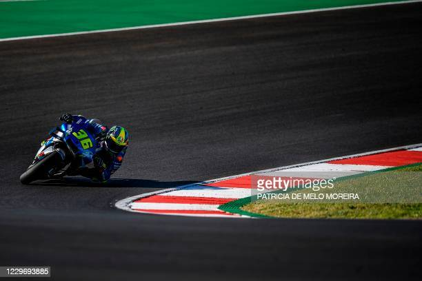 Suzuki Ecstar's Spanish rider Joan Mir takes part in the first practice session of the MotoGP Portuguese Grand Prix at the Algarve International...