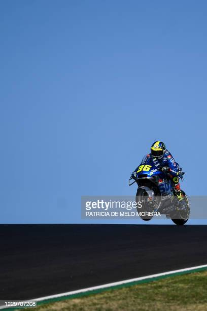 Suzuki Ecstar's Spanish rider Joan Mir takes part in the third practice session of the MotoGP Portuguese Grand Prix at the Algarve International...