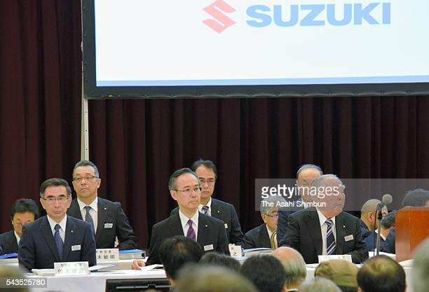 Suzuki Motor Co CEO and Chairman Osamu Suzuki and President Toshihiro Suzuki wait for the opening of the annual shareholders' meeting on June 29 2016...