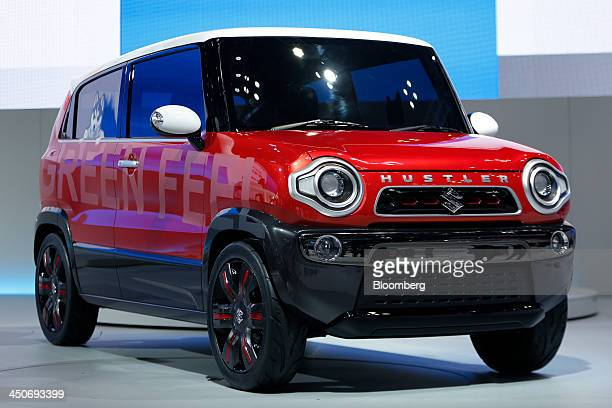 A Suzuki Motor Corp Hustler Coupe concept vehicle stands on display at the 43rd Tokyo Motor Show 2013 in Tokyo Japan on Wednesday Nov 20 2013 The...