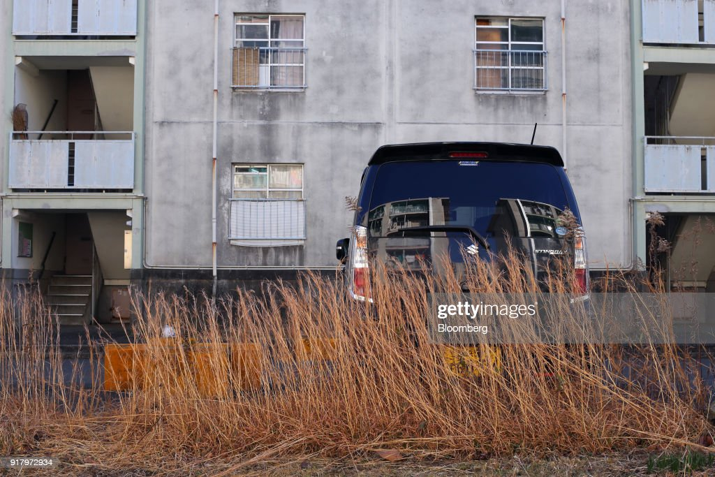 A Suzuki Motor Corp. Stingray vehicle sits parted at a public housing complex in the Totsuka ward of Yokohama, Japan, on Sunday, Feb. 4, 2018. Japans economy expanded for an eighth quarter, with its gross domestic product (GDP) grew at an annualized rate of 0.5 percent in the three months ended Dec. 31, but the pace of growth fell sharply and missed expectations. Photographer: Takaaki Iwabu/Bloomberg via Getty Images