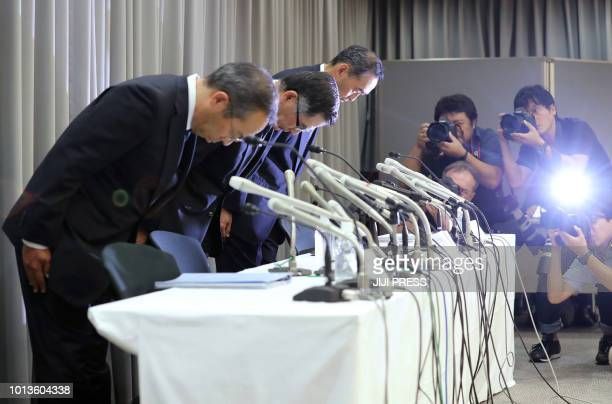 Suzuki Motor president Toshihiro Suzuki bows with other executives during a press conference in Tokyo on August 9 2018 Japan's Suzuki Motor Mazda and...