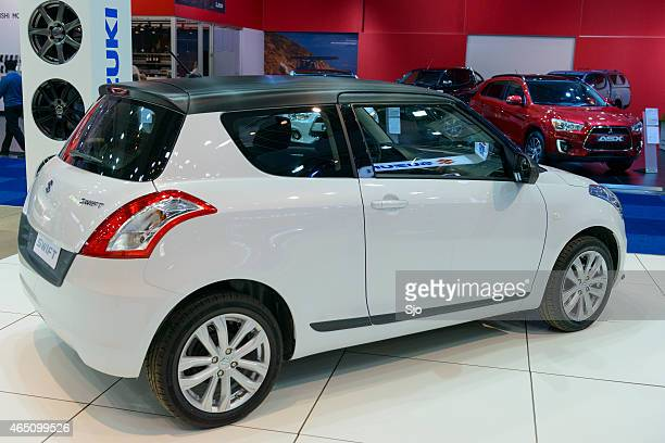 suzuki swift compact hatchback car - swift river stock photos and pictures