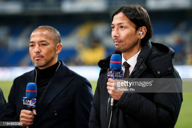 Suzuki Takayuki former national player of Japan looks on during the EAFF E-1 Football Championship match between South Korea and Japan at Busan Asiad...