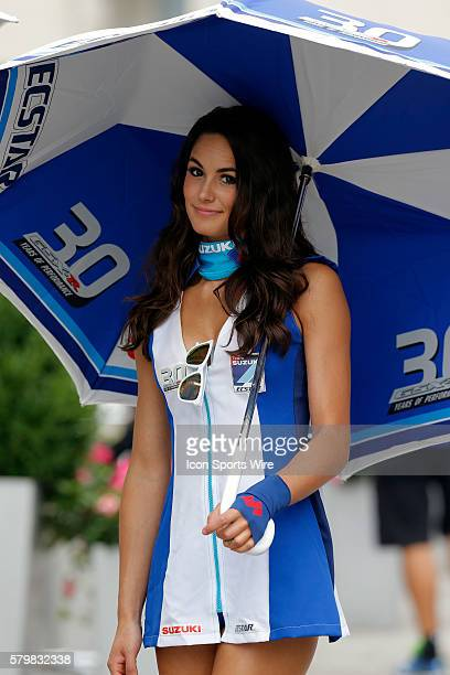 Suzuki umbrella girl poses for a picture during the Indianapolis Red Bull MOTO GP at the Indianapolis Motor Speedway Indianapolis IN