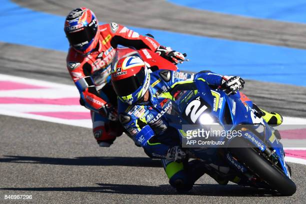 Suzuki's French rider Philippe Vincent competes ahead of Honda's French rider Gregory Leblanc during the first qualifying session of the 81st Bol...