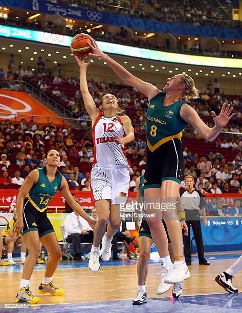Suzy Batkovic of Australia blocks the shot of Natallia Marchanka of Belarus during the women's preliminary basketball game at the Beijing Olympic...