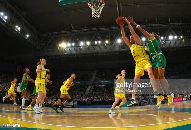 Suzy Batkovic of Australia gets to the ball ahead of her opponent during the first match between the Australian Opals and Brazil at Hisense Arena on...