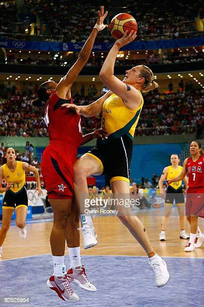 Suzy Batkovic of Australia goes up for a shot against Tina Thompson of the United States during the women's basketball bronze medal game at the...