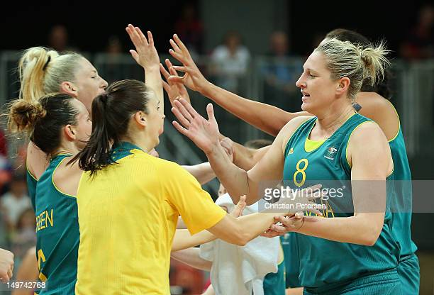Suzy Batkovic of Australia highfives teammates after scoring against Russia during the Women's Basketball Preliminary Round match on Day 7 of the...