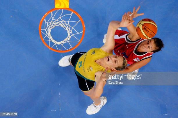 Suzy Batkovic of Australia reaches for a rebound against Edita Sujanova 10 of Czech Republic during their quaterfinal women's basketball match on Day...