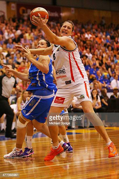 Suzy Batkovic of the Fire and Kelsey Griffin of the Spirit contest for the ball during the WNBL Grand Final match between Bendigo Spirit and...