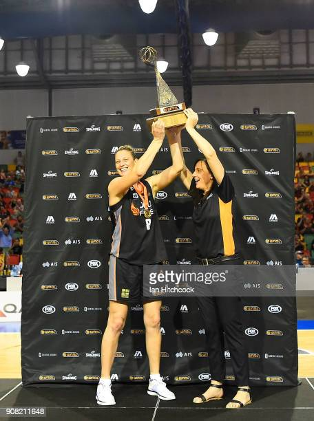 Suzy Batkovic of the Fire and MVP and Fire coach Claudia Brassard lift the WNBL Championship trophy after winning game three of the WNBL Grand Final...