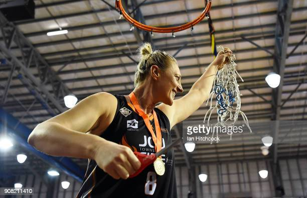 Suzy Batkovic of the Fire and MVP celebrates after winning game three of the WNBL Grand Final series between the Townsville Fire and Melbourne...