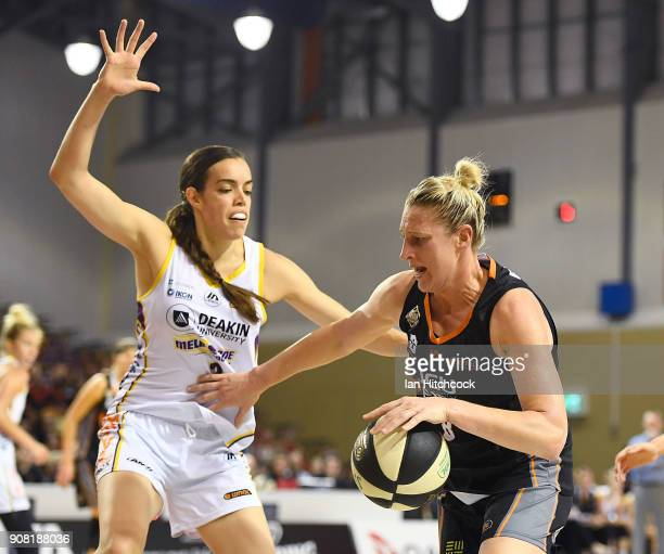 Suzy Batkovic of the Fire drives to the basket past Louella Tomlinson of the Boomers during game three of the WNBL Grand Final series between the...