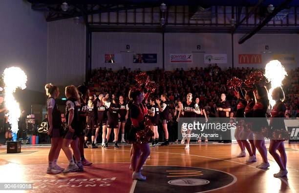 Suzy Batkovic of the Fire enters the court during game one of the WNBL Grand Final series between the Townsville Fire and Melbourne Boomers at...
