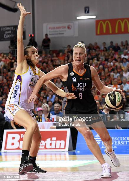 Suzy Batkovic of the Fire takes on the defence during game one of the WNBL Grand Final series between the Townsville Fire and Melbourne Boomers at...