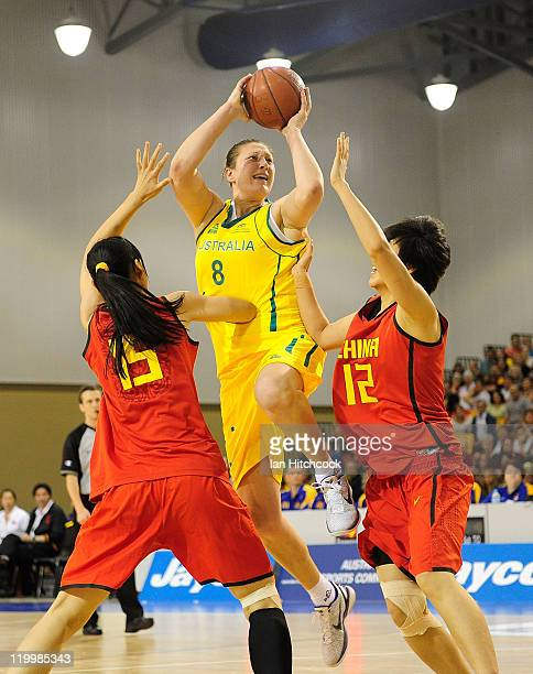 Suzy Batkovic of the Opals attempts a layup past Nan Chen and Song Gao of China during game two of the series between the Australian Opals and China...