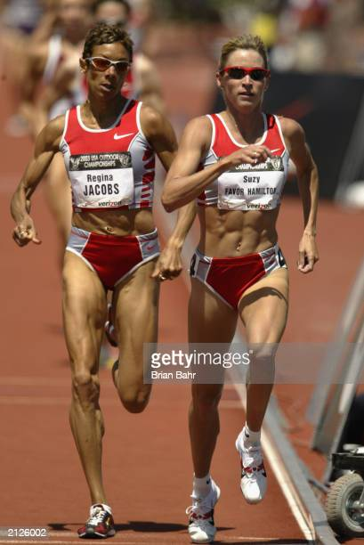 Suzy Favor Hamilton of Nike leads Regina Jacobs of Nike in the women's 1500m final at the USA Outdoor Track and Field Championships at Cobb Track and...